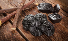 Production steps of licorice, roots, pure blocks and candy. Stock Photo