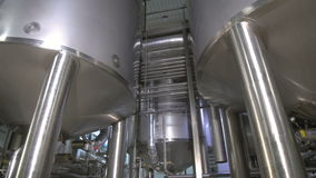 Production tanks, storages at a brewery. Pipline at a brewery factory. stock video footage
