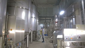 Production tanks, storages at a brewery. Pipline at a brewery factory. stock video