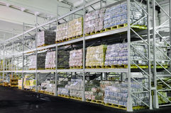 Production in warehouse shelves Royalty Free Stock Images