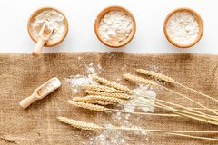 Production of wheat and rye flour from ear on white desk background top view Royalty Free Stock Photo