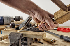 Production of wooden parts with a chisel. Treatment of wooden parts with a chisel stock photography