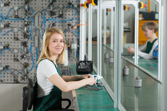 Production worker in manufacturing plant. Young female production worker in manufacturing plant stock images