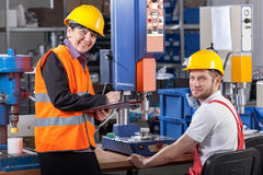 Production worker at workplace and supervisor stock images