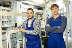 Production workers in coverall Royalty Free Stock Photo