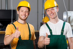 Production workers showing thumbs up sign. Happy production workers showing thumbs up sign Stock Photography