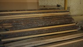 Production workshop on the sawmill where woodwork is made and sawing boards, power-saw bench. Production workshop on the sawmill where woodwork is made and stock video