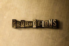 PRODUCTIONS - close-up of grungy vintage typeset word on metal backdrop Stock Photography