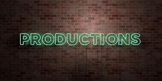 PRODUCTIONS - fluorescent Neon tube Sign on brickwork - Front view - 3D rendered royalty free stock picture Stock Photos