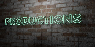 PRODUCTIONS - Glowing Neon Sign on stonework wall - 3D rendered royalty free stock illustration Royalty Free Stock Photography