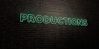 PRODUCTIONS -Realistic Neon Sign on Brick Wall background - 3D rendered royalty free stock image Royalty Free Stock Photos