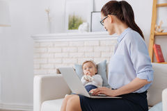 Free Productive Business Lady Paying Attention To Her Child Royalty Free Stock Photography - 88223167