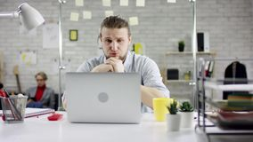 Productive businessman leaning back finishing office work on laptop, effective manager satisfied with meeting deadline. Feels relief after job done, stretching stock footage