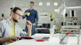 Productive businessman leaning back finishing office work on laptop, effective manager satisfied with meeting deadline. Feels relief after job done, stretching stock video footage