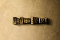 PRODUCTIVE - close-up of grungy vintage typeset word on metal backdrop. Royalty free stock illustration.  Can be used for online banner ads and direct mail Stock Image