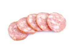 Producto de carne. Salchicha aislada en blanco Imagen de archivo