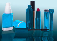 Productos cosméticos en azul Imagen de archivo libre de regalías
