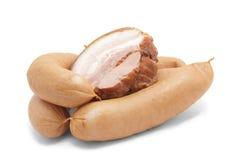 Productos de carne aislados en blanco Imagen de archivo libre de regalías