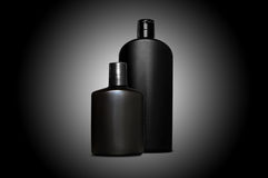 Productos de cuidado de piel personales para los hombres sobre negro Imagen de archivo libre de regalías