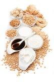 Productos de la soja en blanco Imágenes de archivo libres de regalías