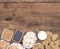 Productos de la soja en la opinión superior del fondo de madera Imagen de archivo