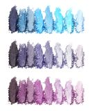 Productos de maquillaje machacados en el fondo blanco fotografía de archivo