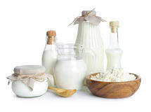 Productos lácteos puros aislados en el fondo blanco Imagen de archivo libre de regalías