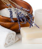 Products for bath, SPA, wellness and hygiene. Natural soap, lavender, sea salt, candles and a towel, close-up Stock Image