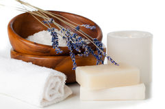 Products for bath, SPA, wellness and hygiene,. Products for bath, SPA, wellness and hygiene: natural soap, lavender, sea salt, candles and a towel, close-up Royalty Free Stock Image