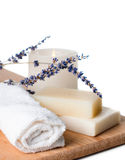 Products for bath, SPA, wellness and hygiene,. Products for bath, SPA, wellness and hygiene: natural soap, lavender, sea salt, candles and a towel, close-up Stock Photo