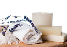 Products for bath, SPA, wellness and hygiene,. Products for bath, SPA, wellness and hygiene: natural soap, lavender, sea salt, candles and a towel, close-up Stock Image