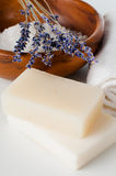 Products for bath, SPA, wellness and hygiene. Natural soap, lavender, sea salt, candles and a towel, close-up Stock Photos