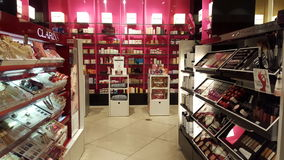 Products for beauty, body care and make-up. Perfumes. Shop shelves Stock Photo