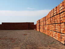Products brickfield. Just made red bricks stacked in several rows for sale stock photography