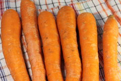 Products with carotene. Washed fresh carrots on a fabric texture. soft focus Royalty Free Stock Images