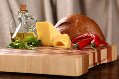 Products on a chopping board Stock Photography