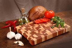 Products on a chopping board Stock Images
