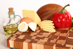 Products on a chopping board Stock Image