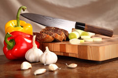 Products on a chopping board Royalty Free Stock Photo