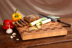 Products on a chopping board Stock Photo