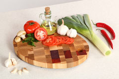 Products on a chopping board Royalty Free Stock Image