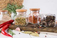 Products for cooking in kitchen, kitchen utensils, herbs, colorful dry spices in glass jars. On white  background Royalty Free Stock Images
