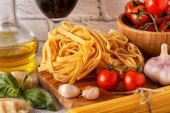 Products for cooking - pasta, tomatoes, garlic, olive oil, basil Royalty Free Stock Images