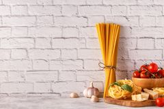 Products for cooking - pasta, tomatoes, garlic, olive oil, basil Stock Images