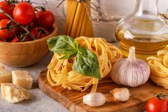 Products for cooking - pasta, tomatoes, garlic, olive oil, basil Stock Image