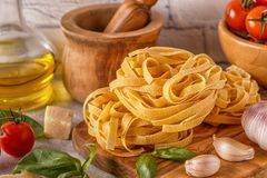 Products for cooking - pasta, tomatoes, garlic, olive oil, basil Stock Photography