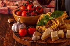 Products for cooking - pasta, tomatoes, garlic, olive oil and re Royalty Free Stock Photography