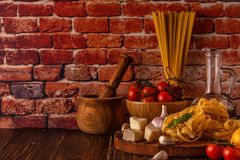 Products for cooking - pasta, tomatoes, garlic, olive oil and re Stock Photos