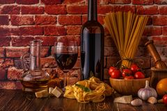 Products for cooking - pasta, tomatoes, garlic, olive oil and re Stock Image