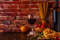 Products for cooking - pasta, tomatoes, garlic, olive oil and re Royalty Free Stock Photo